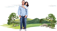 Happy couple standing in front of outdoors scene